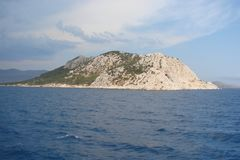 Islands of the southern part of Greece Poros, Hydra, Aegina 06. 15. 2014. The landscape of the Greek islands of hot summer. Panorama of a small Greek island Royalty Free Stock Images