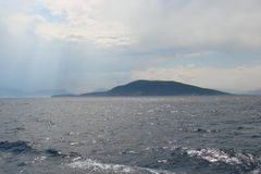 Islands of the southern part of Greece Poros, Hydra, Aegina 06. 15. 2014. The landscape of the Greek islands of hot summer. Panorama of a small Greek island Royalty Free Stock Photography