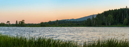 Panorama of a small lake at dusk Royalty Free Stock Image