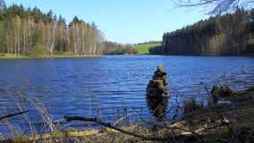 Panorama of small pond in the woods stock video footage