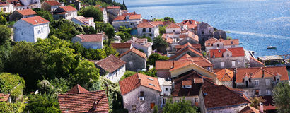 Panorama of the small town near the sea, the Red tiled roofs, Greens Stock Images