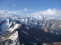 Panorama of snow capped high mountains Stock Photo