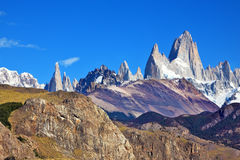 The panorama of snow-capped mountains. Magnificent panorama of snow-capped mountains in Patagonia. Famous rock Fitz Roy peaks in the Andes Stock Photo