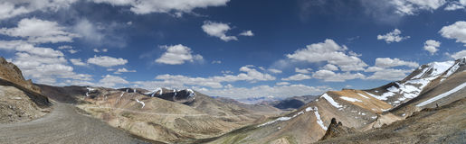 Panorama of snow capped mountains road and valley from Tanglang La pass Stock Images