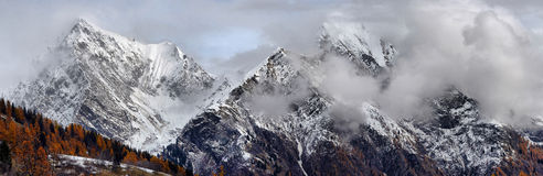 Panorama of snow-capped peaks Stock Photos