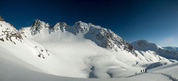 Panorama of snow-covered glacier and mountain peaks of Kyrgyzsta Royalty Free Stock Photography