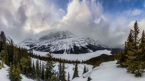 A panorama of the snow covered Peyto Lake in Banff National Park royalty free stock photos