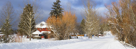 Panorama of a snow covered road. A panoramic image of a snow covered country road Royalty Free Stock Image
