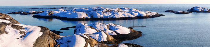 Panorama of snow-covered rocky coast of the North Sea Royalty Free Stock Image