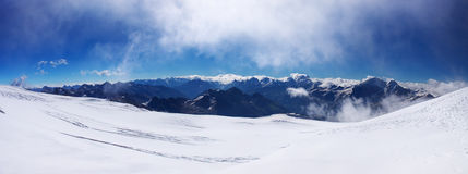 Panorama snow declivity. And array of the mountains Stock Photo