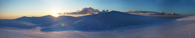 Panorama of snow mountain landscape with blue sky Stock Photo