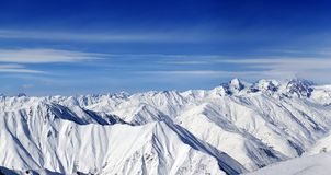Panorama of snow mountains and blue sky Stock Image