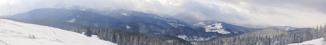 Panorama of snowed mountains. In winter Royalty Free Stock Image