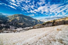 Snowy alpine valley. Panorama of snowy alpine valley Royalty Free Stock Photography