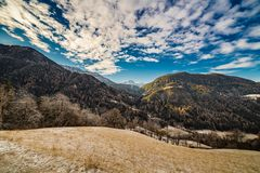Snowy alpine valley. Panorama of snowy alpine valley Royalty Free Stock Photos