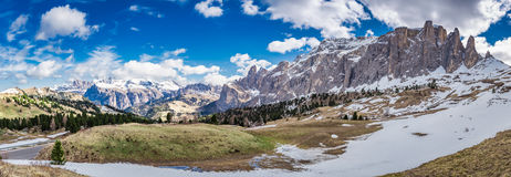 Panorama of snowy Dolomites in spring in sunny day, Italy Stock Photo