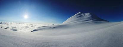 Panorama of snowy mountain at sunrise Royalty Free Stock Image