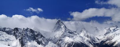 Panorama of snowy mountains Stock Photography