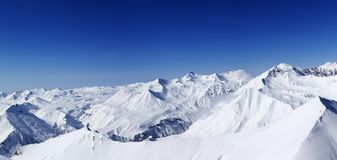 Panorama of snowy mountains in nice day Royalty Free Stock Photo