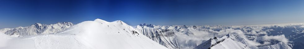 Panorama of snowy mountains with off-piste slope Stock Image