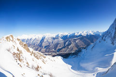 Panorama of snowy mountains from the peak in Sochi Stock Photos