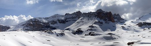 Panorama of snowy mountains Royalty Free Stock Images