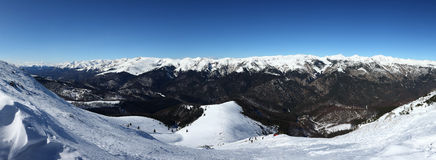 Panorama of Snowy Peaks in a Mountain Range Royalty Free Stock Image