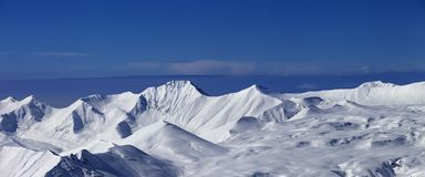 Panorama of snowy plateau at nice day Stock Image