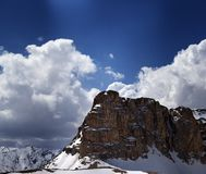 Panorama of snowy rocks and sky with sunbeam in nice spring day Royalty Free Stock Images