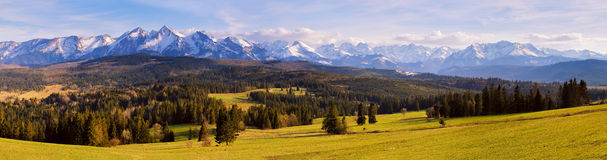 Panorama of snowy Tatra mountains in spring, south Poland. Malopolska Royalty Free Stock Photo