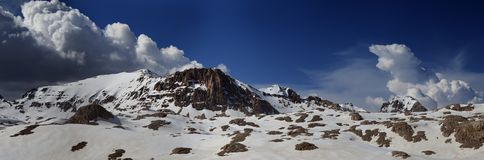 Panorama of snowy winter mountains Stock Images