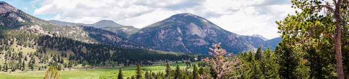 Panorama of the solar mountain valley. Travel to the Rocky Mountain National Park. Colorado, United States. Summer high mountain valley. Rocky Mountain National royalty free stock image