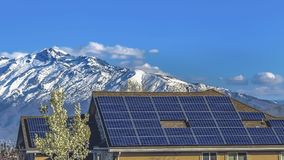 Free Panorama Solar Panels Installed On The Roof Of Home Against Snowy Mountain And Blue Sky Royalty Free Stock Photo - 154837815