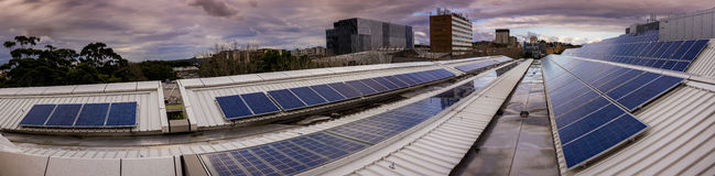 Panorama of solar panels on rooftop Stock Photo