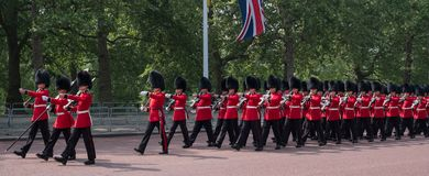 Panorama of soldiers in traditional uniform march down The Mall in London during Trooping of the Colour parade stock photo