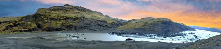 Panorama from Solheimajokull Glacier in Iceland at sunset Stock Photos