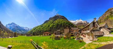 Panorama of Sonogno village of stone houses. SONOGNO, SWITZERLAND - 21 APRIL 2018 - Panorama view of Sonogno village with plenty of stone houses and typical Stock Photos