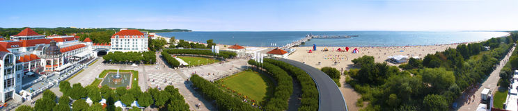 Panorama of Sopot Resort in Poland. Wide panorama of Sopot resort in Poland in summer, with beach, pier Molo, Gdansk Bay, promenades, hotels, restaurants Royalty Free Stock Image