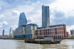 Panorama of south bank of the Thames River in central London, UK.  royalty free stock image