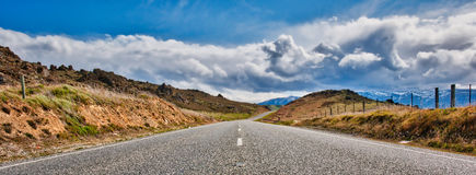 Panorama of South Island Road. A South Island Road leads us to a Mountain Range Royalty Free Stock Images
