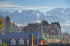 Panorama with a Spire in Thun and the Alps. Thun is a city in the canton of Bern in Switzerland, where the Aare river flows out of Lake Thun. There is a view Royalty Free Stock Photos