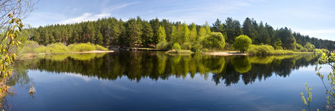 Panorama of the spring river. Stock Photos