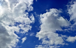 Panorama of spring, summer clouds on a blue sunny sky, backgroun Stock Images