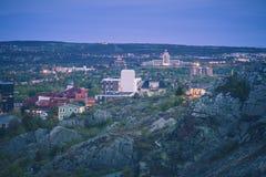 Panorama of St. John`s at night stock image