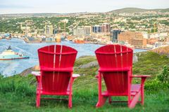 Panorama of St. John`s with two characteristic red chairs, Newfo Royalty Free Stock Photo