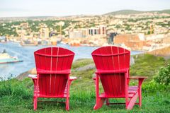 Panorama of St. John`s with two characteristic red chairs, Newfo Stock Image