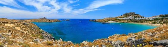 Panorama St. Paul Bay near Lindos, Rhodes cluoads sunny day. St. Paul Bay near Lindos, Rhodes sunny day stock photos