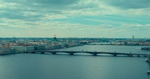 Panorama of St Petersburg, Russia, with Palace bridge over Neva river, golden dome of St Isaac cathedral, Admiralty. Building and Rostral Column stock video footage