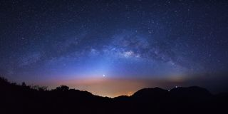 Panorama starry night sky with high moutain at Doi Luang Chiang. Dao and milky way galaxy with stars and space dust in the universe royalty free stock image