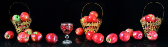 Panorama a still life with a glass of wine and apples. Large-format panorama a still life of a harvest of apples with a glass of wine Royalty Free Stock Photo